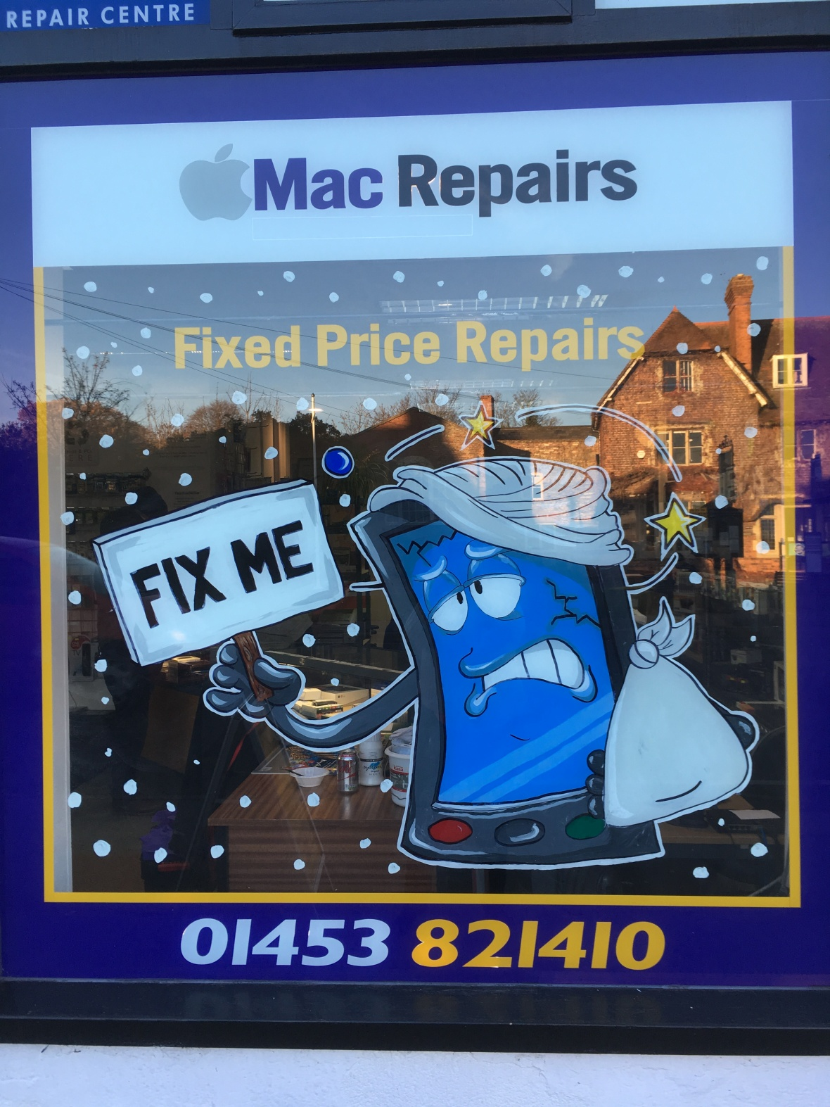 Custom we fix phones window graphics hand painted for shops and companies in Gloucestershire & Bristol