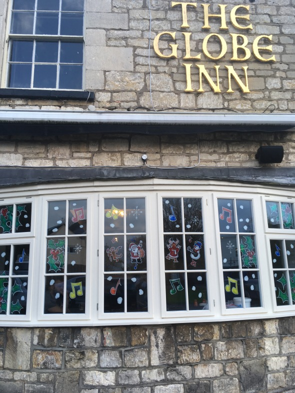 Christmas window painting for a pubs window decorations.